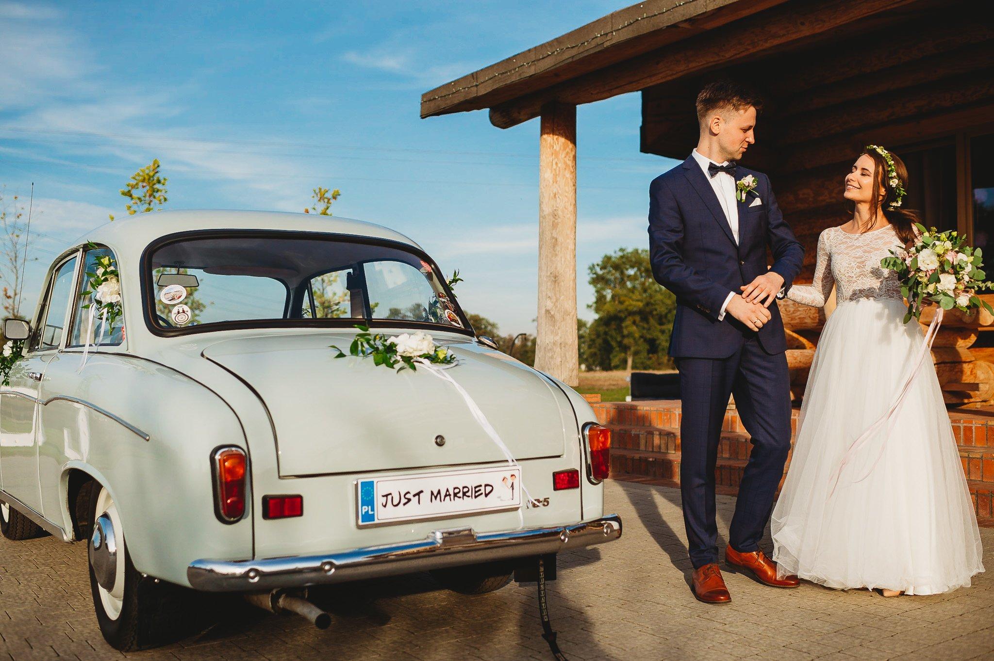Fantastyczny ślub w stylu rustykalnym, wesele w Kapitańskiej  fotograf ślubny Konin 187